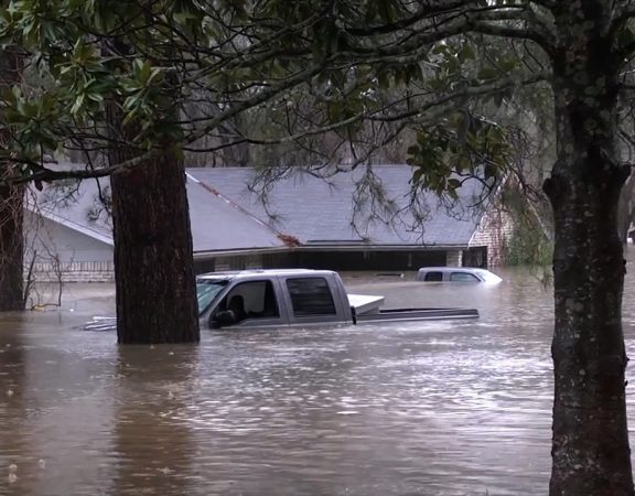 After more than 14 inches of rain fell in Bossier Parish, Louisiana, officials there said they closed at least 100 roads and issued a mandatory evacuation order for some residents.